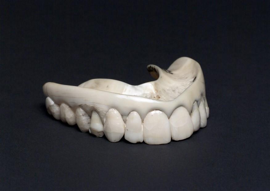 Upper ivory denture with human teeth